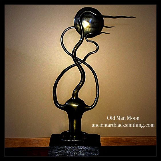 Hand forged metal and stone sculpture.