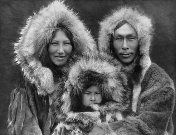 A family photo of an Eskimo mother, father, and son, photographed in Noatak, Alaska, by Edward Sheriff Curtis circa 1929. The scan was made from a black and white film copy negative
