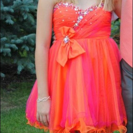 Homecoming/Formal Dress Absolutely love this dress! Pink/orange beaded dress. Removable bow. Originally size 6 but tailored to a 4. Worn once! Dresses