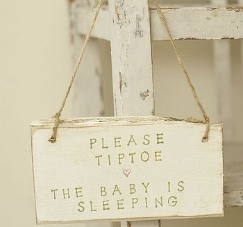 Cute sign to remind visitors there is a baby in the house... as if they will need reminding!