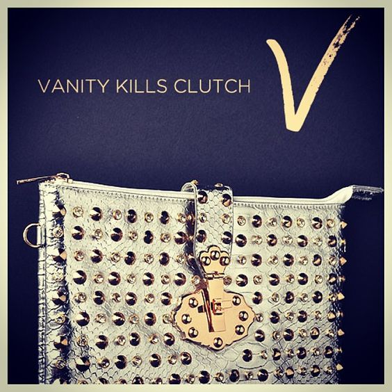 Vanity Kills Clutch: Get the clutch that kills. In silver or black, rock this snake skinned, spiked, and studded clutch with back storage and detachable wristlet handle. As you take over the night, match this clutch with a black peplum dress and black stilettos adorned with gold studding.