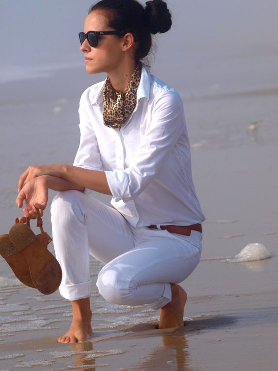 A summer classic! White jeans & white button down shirt.