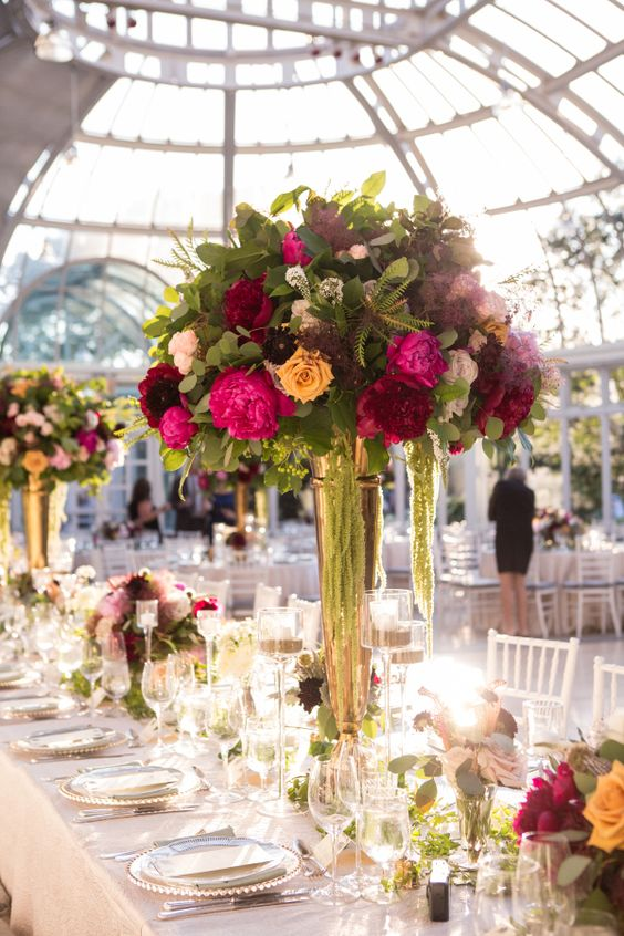 Bold centerpieces in brass flutes: http://www.stylemepretty.com/new-york-weddings/new-york-city/brooklyn/2017/01/18/this-is-how-you-do-a-wedding-at-the-brooklyn-botanic-garden/ Photography: A Gy and a Girl - http://aguyandagirlphotography.com/