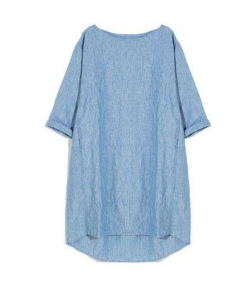 Jurk caftan - <ul><li>100% Belgisch linnen</li><li>Boothals</li><li>Achter is de jurk iets langer</li><li>chterpas met diepe plooi</li><li>Steekzakjes</li><li>Omgeslagen cropped mouw</li><li>Gemaakt in ons atelier in Turkije<li/></ul>