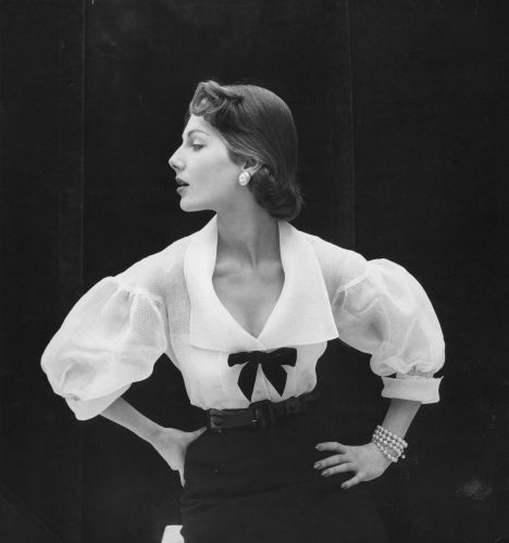Fiona Campbell-Walter wearing a white organdy blouse. Photographed by John Deakin for Vogue, 1950s.