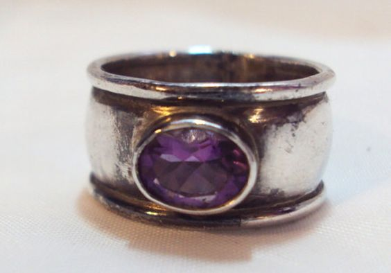 Heavy Wide Band Amethyst Ring Unisex size 8 1/2.  Fabulous wide band ring with amethyst stone. Ring is 1/2 inch wide ad a size 8 1/2 . Stone is 3/8 inches. Natural patina. ... #teamlove #vogueteam