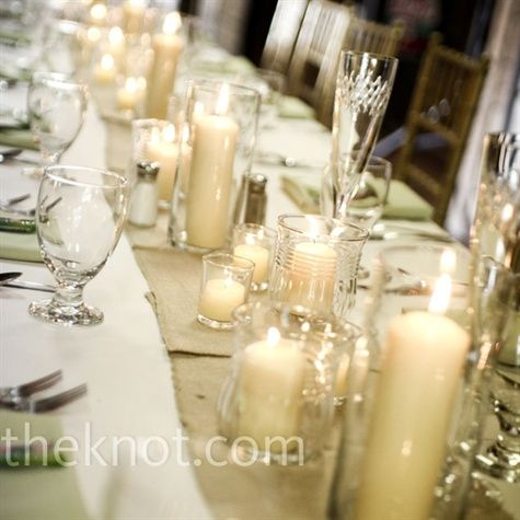 Dozens of six and four inch votives were peppered on the tables to create a romantic vibe.