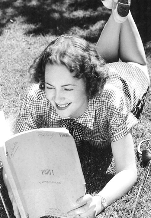 ruthelizabeths:  Olivia de Havilland goes over the script of Captain Blood, 1935: