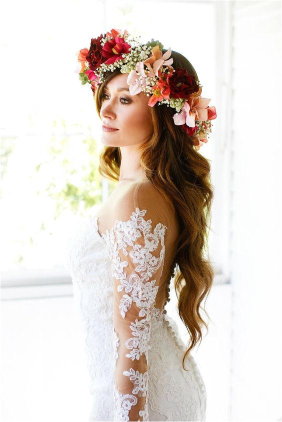 Boho bride wearing a colorful flower crown