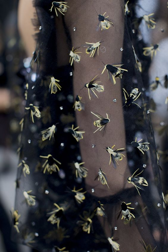 Bees caught in a net or bees foraging. Sleeve detail. Chanel Couture AW 2016