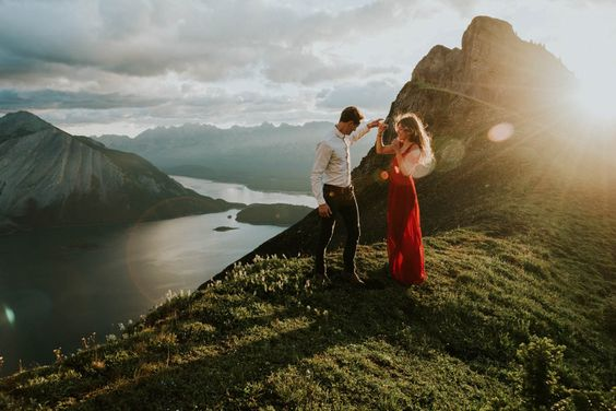 This golden hour sweetheart session in the mountains of Kananaskis Country will take your breath away with stunning mountaintop views and a bold red dress.