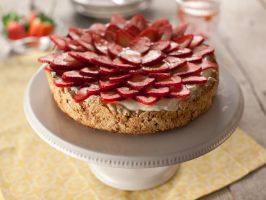 Marcela's Strawberry Meringue Cake (Mostachon) : Marcela Valladolid's summery dessert starts with a meringue-cake base, then moves up to a cream cheese frosting and is eventually crowned by fresh, plump strawberries.