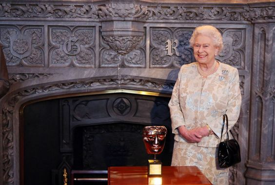 Queen Elizabeth II receives an honorary British Academy award (Bafta) Thursday April 4 2013, at Windsor Castle, west of London, from actor and director Kenneth Branagh,