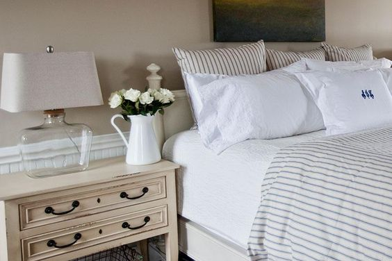 French style farmhouse bedroom with ticking stripe bedding