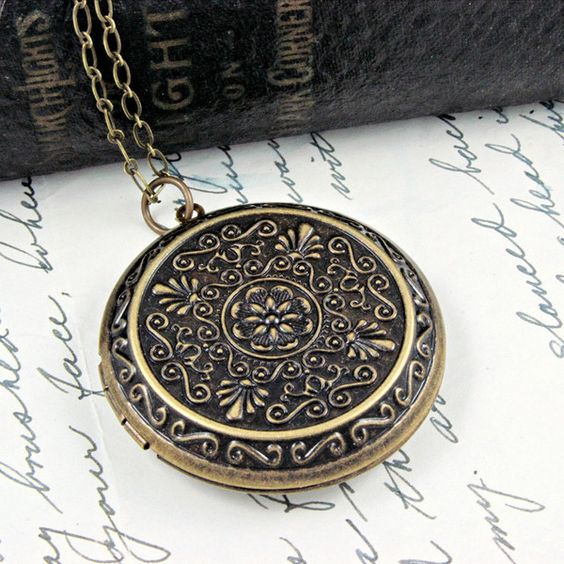 Large victorian style antique brass locket necklace. Bohemian large locket. A long beautiful elegant simple piece! Great layered or alone.
