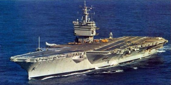 The U.S. Navy aircraft carrier USS Enterprise (CVN-65) underway after her refit, in 1982. Note the single Douglas A-4E/F Skyhawk on deck.