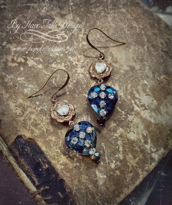 """Timeless earrings featuring deep blue crystal hearts with antique rhinestone cross center, ornate brass connector with vintage heart crystal center. Earrings hooks are lead and nickel free, hypoallergenic measure 2.5"""" long, lightweight"""