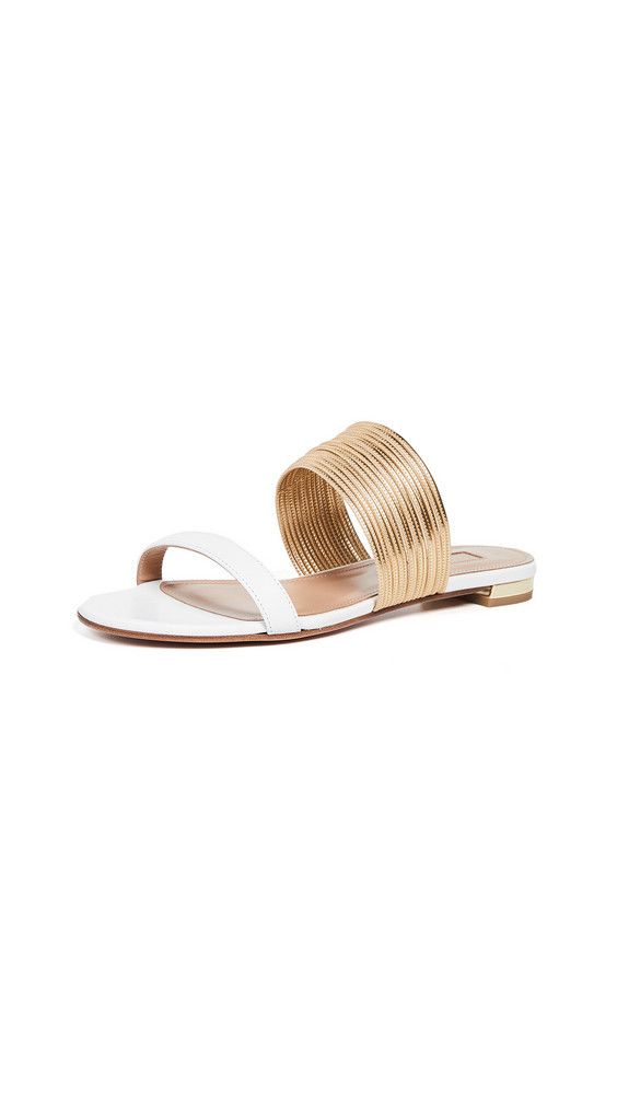 purple nike sandals with gold check