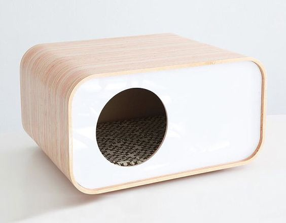 Modern Cat House  Etsy seller ModernMews designed this bad boy, which doubles as a low end table or night stand.