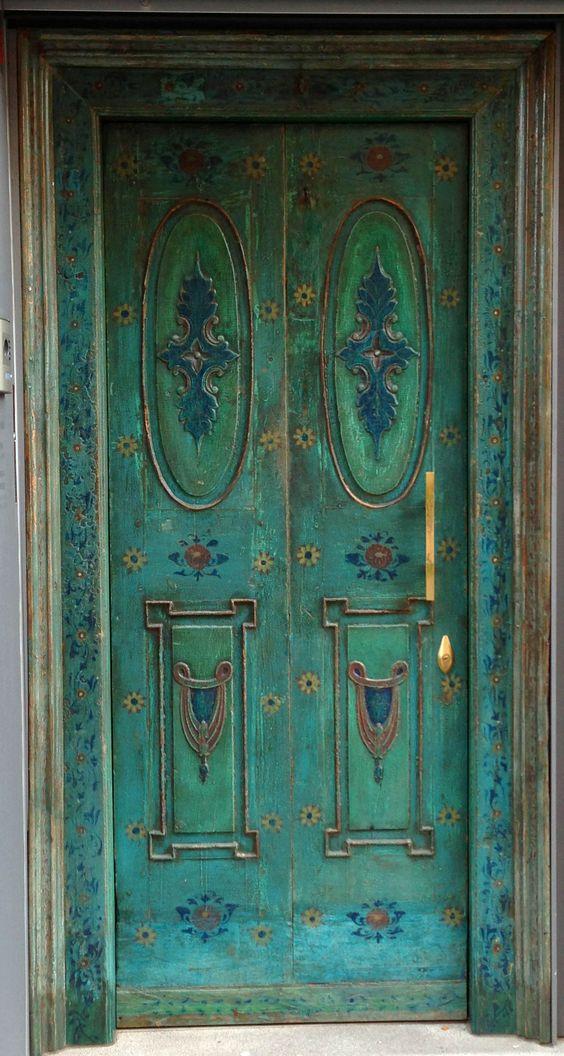 Green and blue door in Manresa, Spain: