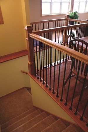 Stair systems wrought iron balusters in dining room for Pre built staircase