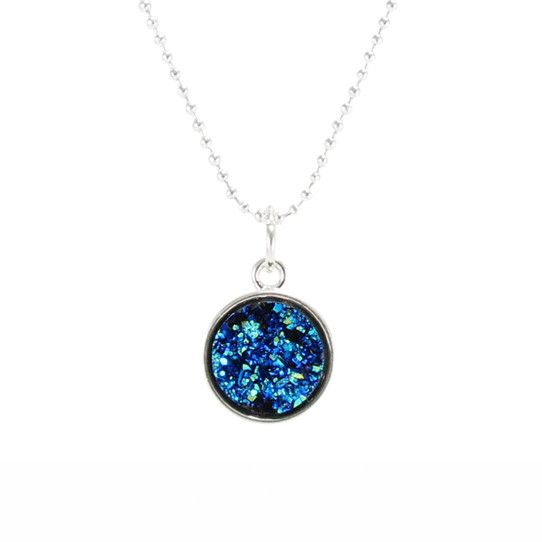 This sparkling blue necklace is magical! Shimmers beautifully in the light! Each piece is set in a petite 13 mm frame and hung on a 24 inch silver plated ball c