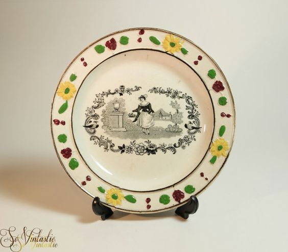 Early Dawson creamware child's plate by John Dawson's Low Ford Pottery, Sunderland, UK. c1825 glazed English earthenware bread and butter plate. Black transfer scene of a lady with a flower basket. Adorable enamelled moulded border decoration (floral). No chips / cracks! On offer by SoVintastic on Etsy;-)