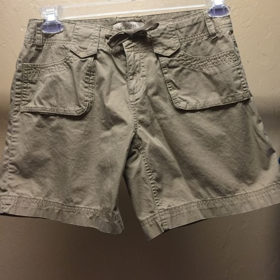 "Size 4 khaki shorts Nice khaki shorts size 4. Natural reflections by Bass Pro - zip and tie front. Front and back pockets. Nice fit and comfortable. Length is 14"" Shorts"