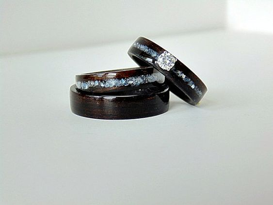 Hey, I found this really awesome Etsy listing at http://www.etsy.com/listing/151453877/wood-engagement-ring-with-matching
