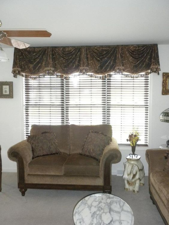 """My client's """"After"""" photo:  Dark wood blinds (for privacy and light control) and a simple but elegant valance with trim that's properly scaled for the room were selected."""