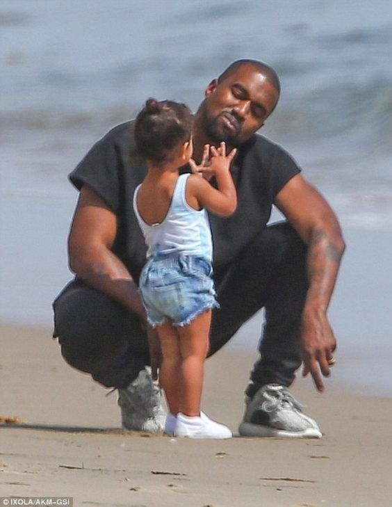 Chatty little miss: North and Kanye appeared to be having a very long and interesting conv...