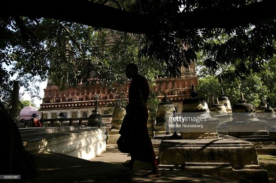 A Tibetan monk walks through some stupas near a Bodhi Tree at the Mahabodhi Temple on July 25, 2005 in Bodhgaya, India. It was underneath the Bodhi Tree where Buddha attained enlightenment in 528 B.C. following years of meditation and from this spot that he set out on his life of preaching.