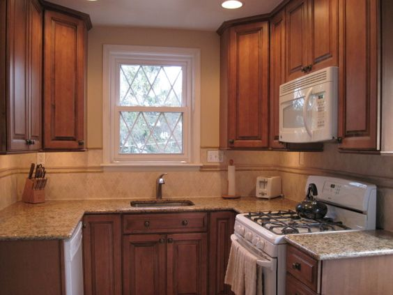 Small kitchen remodel angle on corner cabinets kitchen for Angled corner kitchen cabinets