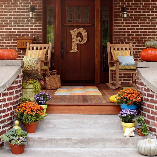 Porch with Monogram and Mums:  To give the front door more personality, use wood glue to attach cut wood dowels to a plywood monogram. Description from pinterest.com. I searched for this on bing.com/images