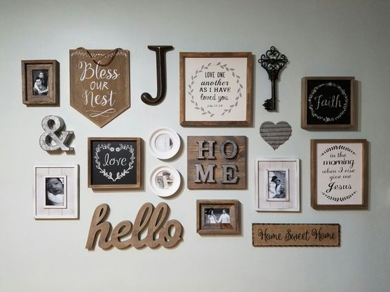 Farmhouse/rustic inspired gallery wall. Hobby lobby 50% off sales for the win! Wall color: Sherwin Williams Sea Salt Instagram: vezizree