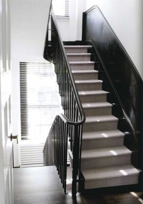 Black stair spindles..but id do a natural, walnut stained..or whitewash stain top rail with black. Sleek, industrial.