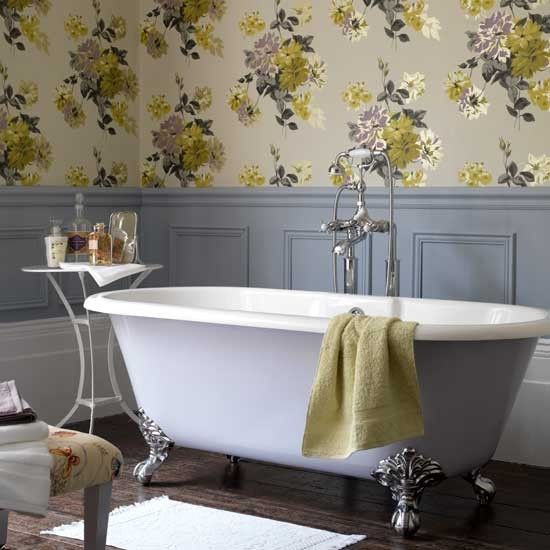 Portier Designers Guild wallpaper makes a stunning accompaniment to grey painted panelling and as a backdrop to elegant roll top bath. Feminine but not fussy.: