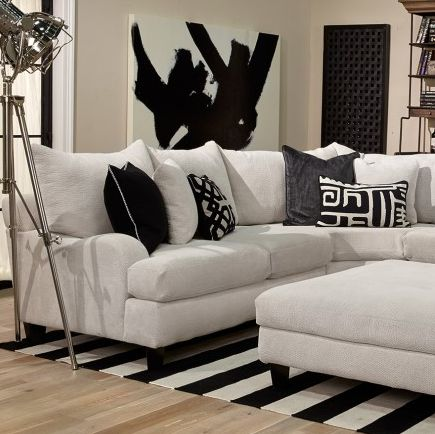 Sectionals are great when you need flexible seating options and are short on space. This sectional has contemporary styling with low rounded arms that provide support without being overpowering. The soft cream fabric is durable and feels amazing. The pillowy back cushions will embrace you with their softness and ample accent pillows give you additional styling options. | Houston TX | Gallery Furniture |