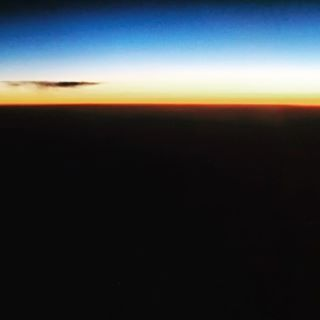 view from the plane window, sunset.