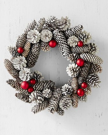 awesome white pinecone wreath with red accents. would look great on my red front door. diy opportunity?
