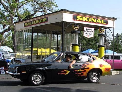 My '79 Pinto wagon had flames painted on the back - somebody either beat me to it or copied me <img border=