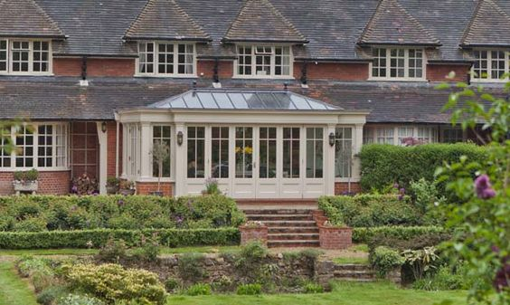 A large property with a traditional conservatory for Conservatory doors exterior