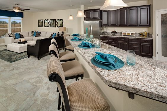 View from the bar in the Darlington plan...oversized kitchen island with bar seating truly accents the space and connects to the living area. Built by Raymus Homes in Manteca, CA