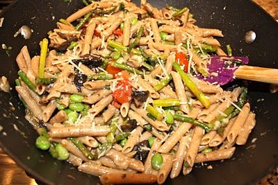 Penne pasta with asparagus, mushrooms, bursted tomatoes and parmesan cheese. DE-LISH!