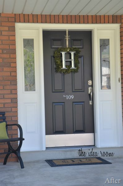 black front door - could also paint wicker chairs black and add a rug with a black border