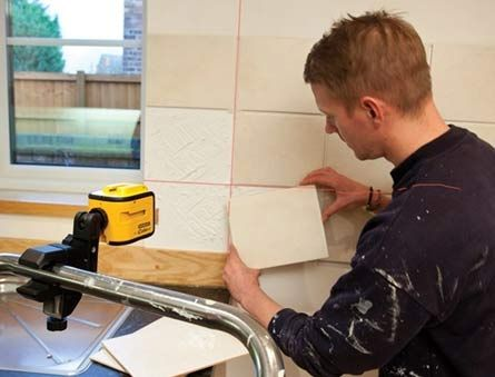 Using a laser Level - Level fixed to a rail and leveled. DIY Doctor's 'How To' Projects.