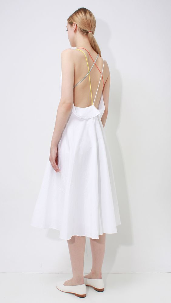 VeronaDress, a lightweight sleeveless open back dress in white. Features a heart neckline, unadjustable spaghetti straps in multi-colored, plunging openback w