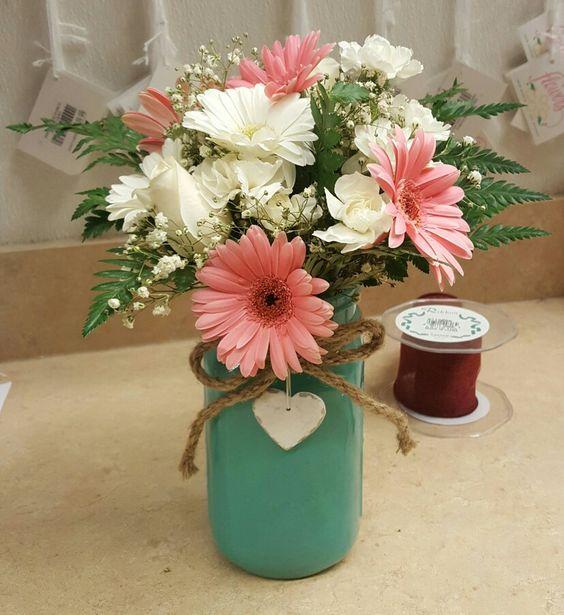 Gerbera rustic centerpieces and mason jars on pinterest