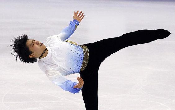 Yuzuru Hanyu of Japan performs during the men's singles short program at the ISU Grand Prix of Figure Skating final in Barcelona, Spain, December 10, 2015.  REUTERS/Albert Gea