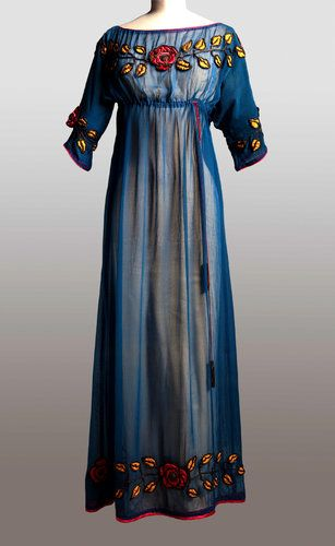Paul Poiret Gown, ca. 1908, Paul Poiret was just one of many fashion designers who ruled the Paris couture market during this time. He was known for his usage of vivid colors, and lack of corsets which can be depicted in the picture above.